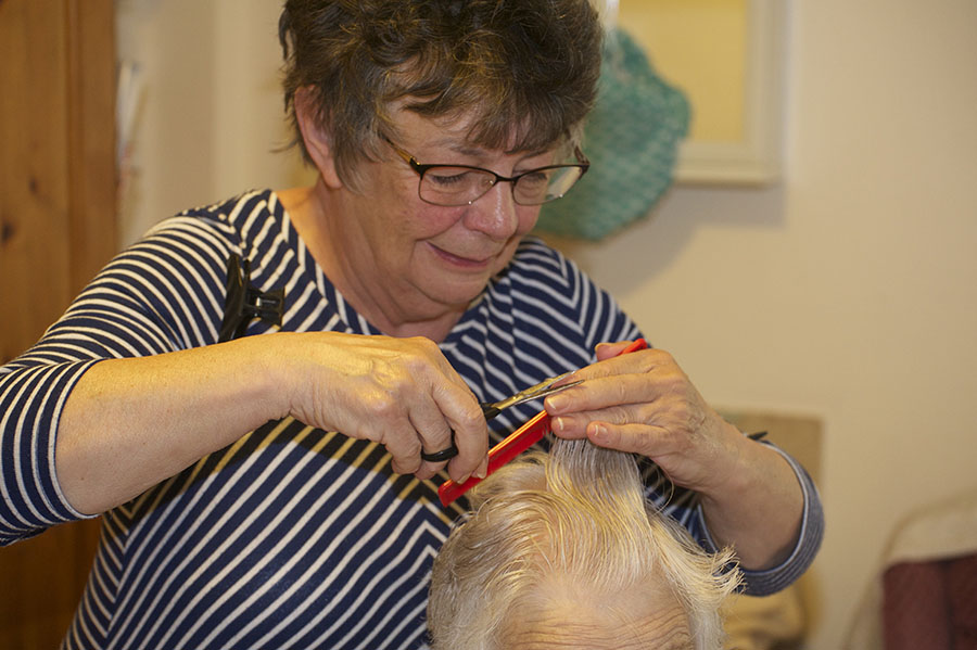 Resident at Brookside having her hair done